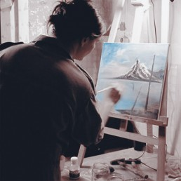 Judith paints in a Bob Ross style.