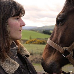 Judith face-to-face with horse.