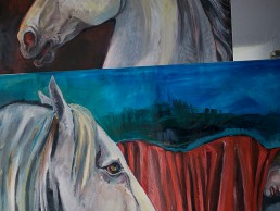 Stacked canvases with white horses